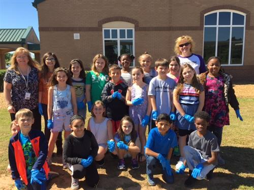 Mrs. Whetstone's Class worked with Mrs. Keller and Mr. Mellin and other Master Gardeners to plant our butterfly garden!