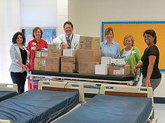 Staff poses with donated hospital supplies